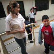 In this file photo, social services worker Bertha Mendez Leyva, 32, watches as deported minors file into a Baja California state social services agency office that helps deported minors locate family on Wednesday, May 3, 2006 in Tijuana, Mexico. The unaccompanied minors were detained while being smuggled into the United States near San Diego. Hundreds of unaccompanied minors a day are crossing the southern border, most of them now from Honduras, Guatamala, and El Salvador.