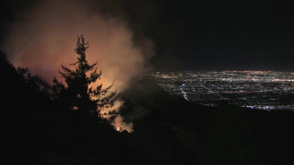 County officials say no structures are immediately threatened by a brush fire that broke out before dawn Tuesday, Oct. 17, 2017, on steep hillsides near the historic observatory on Mt. Wilson above Los Angeles.