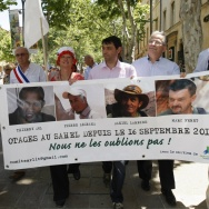 The hostages' families, friends and activists demonstrate in Aix-en-Provence, France, in June.