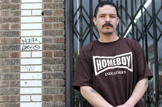 Former gang member who uses the nickname 'Jose Aleman,' 34, wears a Homeboy Industries T-shirt, while posing for a photo on a street in East Los Angeles, California, March 23, 2005.
