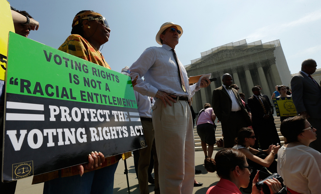 Supporters of the Voting Rights Act listen to speakers discussing today's rulings outside the U.S. Supreme Court building on June 25, 2013 in Washington, DC. The court ruled that Section 4 of the Voting Rights Act, which aimed at protecting minority voters, is unconstitutional. The high court convened again today to rule on some high profile decisions including two on gay marriage and one on voting rights.