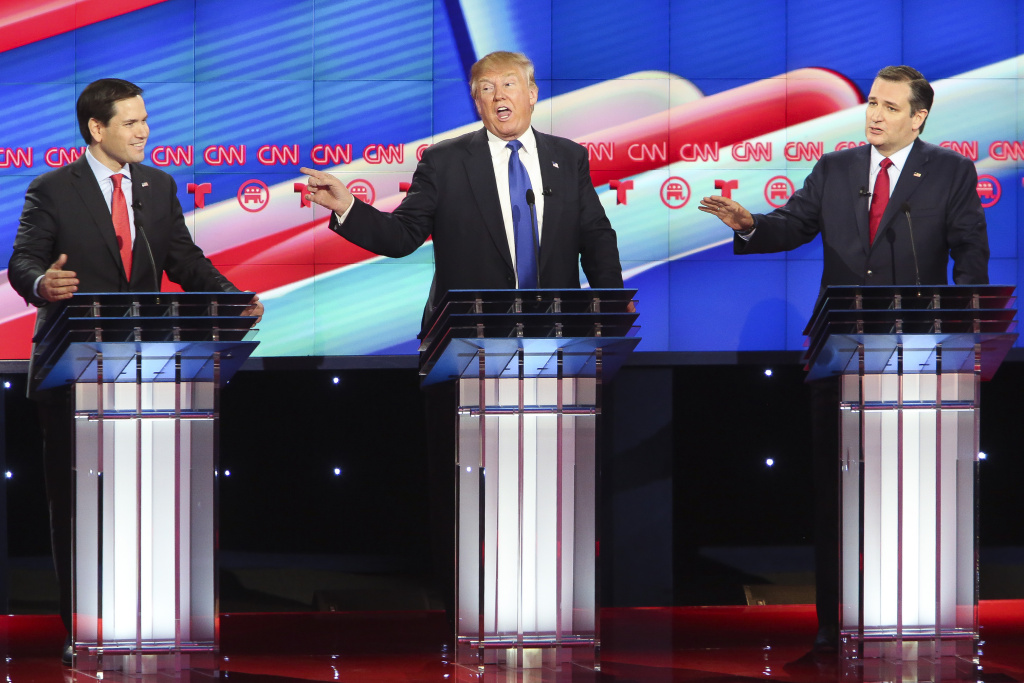 Republican presidential candidates, Sen. Marco Rubio (R-FL), Donald Trump and Sen. Ted Cruz (R-TX) listen as answers a question during the Republican presidential debate at the University of Houston.