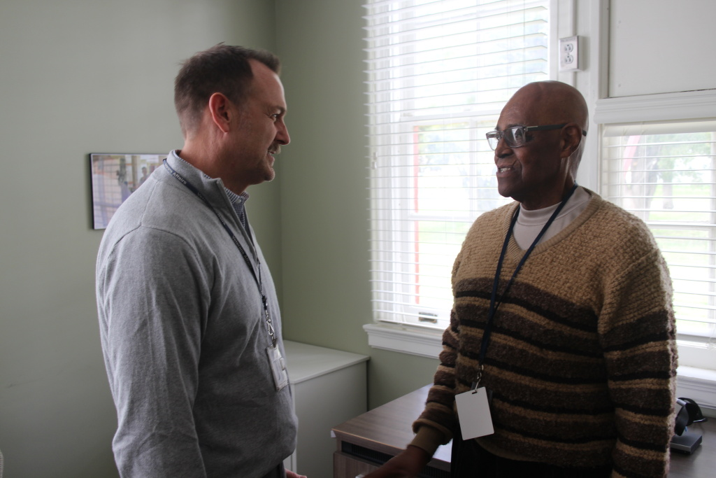 Dr. Greg Serpa (left) speaks with Korean War veteran Melvin Hilliard.