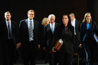 Frank McCourt (center) leaves Los Angeles County Superior Court with his legal team on Aug. 20, 2010, after the first day of a non-jury divorce trial.