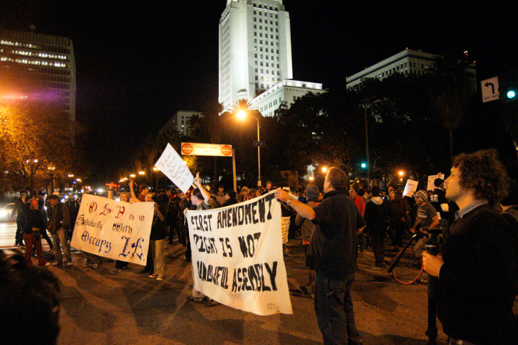 Occupy L.A. protesters took to the streets after the deadline for their eviction from City Hall passed early Monday morning, prompting a police response.