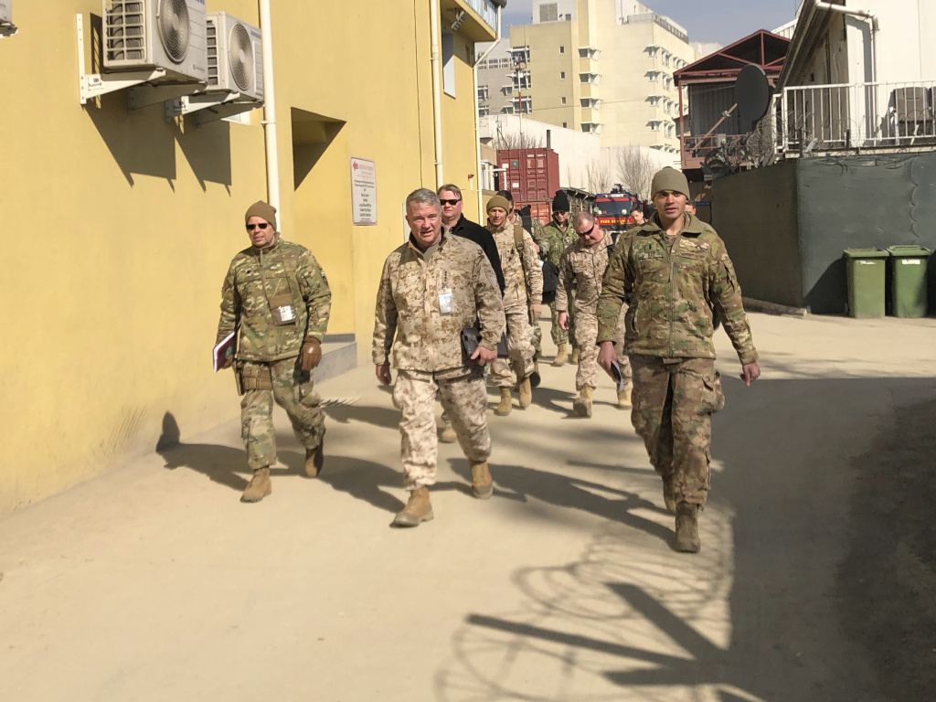 Marine Gen. Frank McKenzie (center) visits Kabul, Afghanistan, in January 2020. The Biden administration said it plans to complete a drawdown of U.S. troops in the country by Sept. 11.