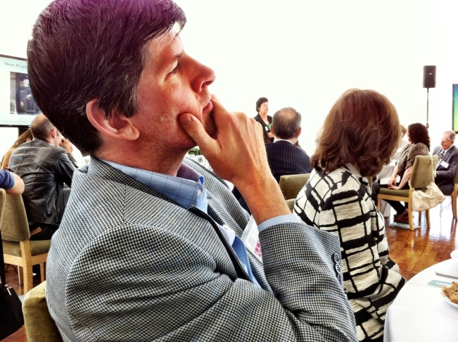 April 16, 2012: Off-Ramp host John Rabe is deep in thought at Getty Foundation chief Deborah Marrow speaks at the annual Getty Press Luncheon..