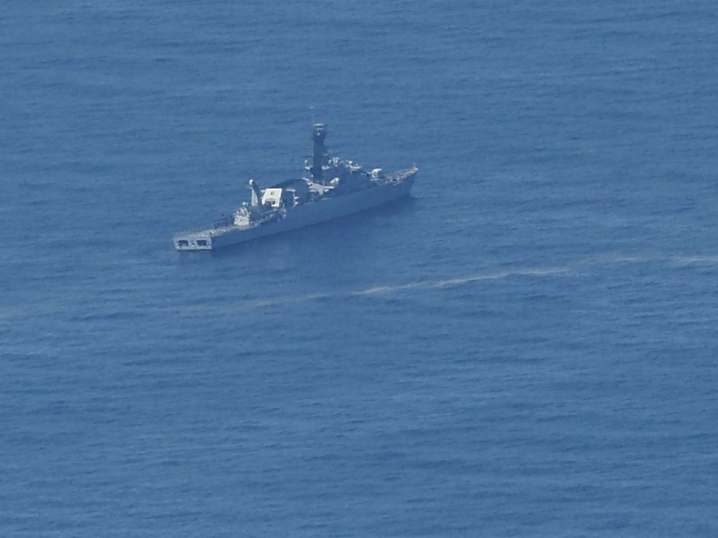 An Indonesian navy ship searches for the submarine KRI Nanggala 402 that went missing this week in the waters off Bali.