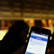 A man checks facebook on his smartphone