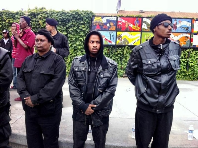 The Black Riders, a new generation of The Black Panthers, stand at the corner of 41st St. and S Central Ave, where the LAPD and The Black Panthers had a shoot out in 1969.