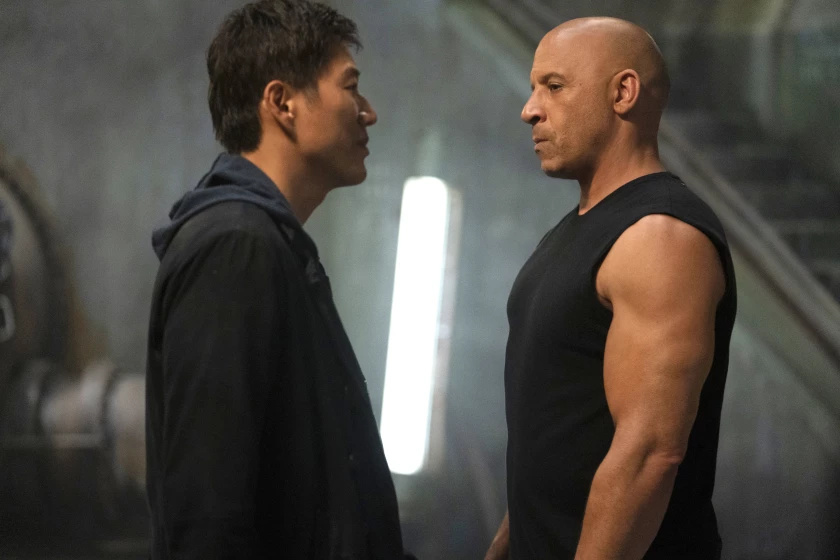 """Sung Kang (L) and Vin Diesel (R) in the film """"F9: The Fast Saga"""