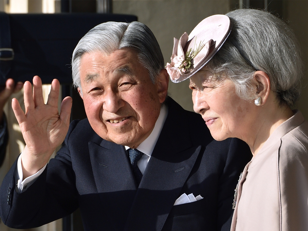 Japan's Emperor Akihito, with Empress Michiko, waves to well-wishers in the central Japanese prefecture of Mie on April 18. Emperor Akihito takes part in a series of rituals ahead of his abdication.