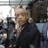 Rev. Al Sharpton, left, and Marc Morial president of the National Urban League, speak to reporters after they met with Sony Pictures co-chair Amy Pascal, on Dec. 18.