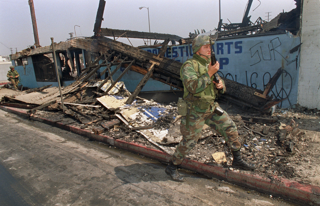 National Guardsmen patrols trough a destroyed area, 01 May 1992 in central Los Angeles. This month is the 20th anniversary of the 1992 Los Angeles riots, when looting and arson events erupted 29 April 1992.
