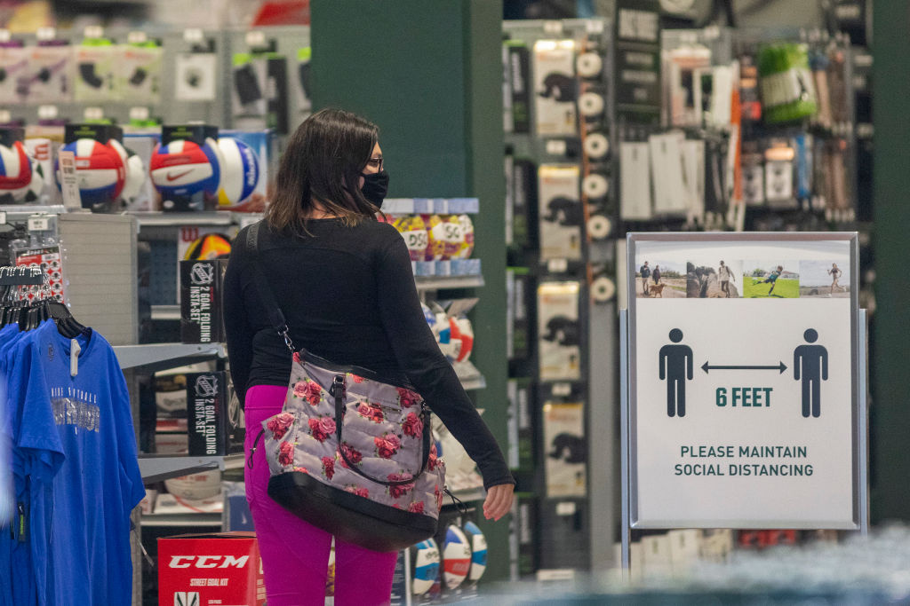 A customer shops in a Dick's Sporting Goods store as Los Angeles County retail businesses reopen while the COVID-19 pandemic continues on May 27, 2020 in Glendale, California.