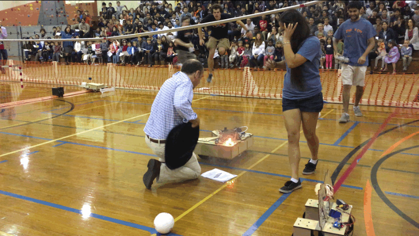 A robot catches fire during the 31st annual Tridroid Cup in a soccer match between robots at Caltech.