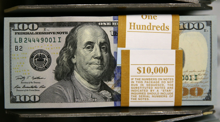 Newly redesigned $100 notes lay in stacks at the Bureau of Engraving and Printing on May 20, 2013 in Washington, DC. The one hundred dollar bills will be released this fall and has new security features, such as a duplicating portrait of Benjamin Franklin and microprinting added to make the bill more difficult to counterfeit.