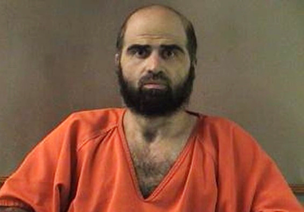 FILE - This undated file photo provided by the Bell County Sheriff's Department shows Nidal Hasan.