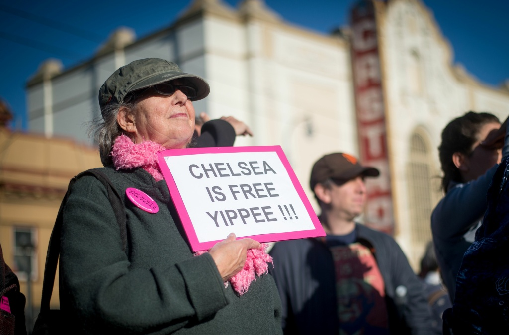 Renay Davis holds up a sign showing support for Chelsea Manning in the Castro District of San Francisco, California on May 17, 2017, during a celebration for Manning's release.