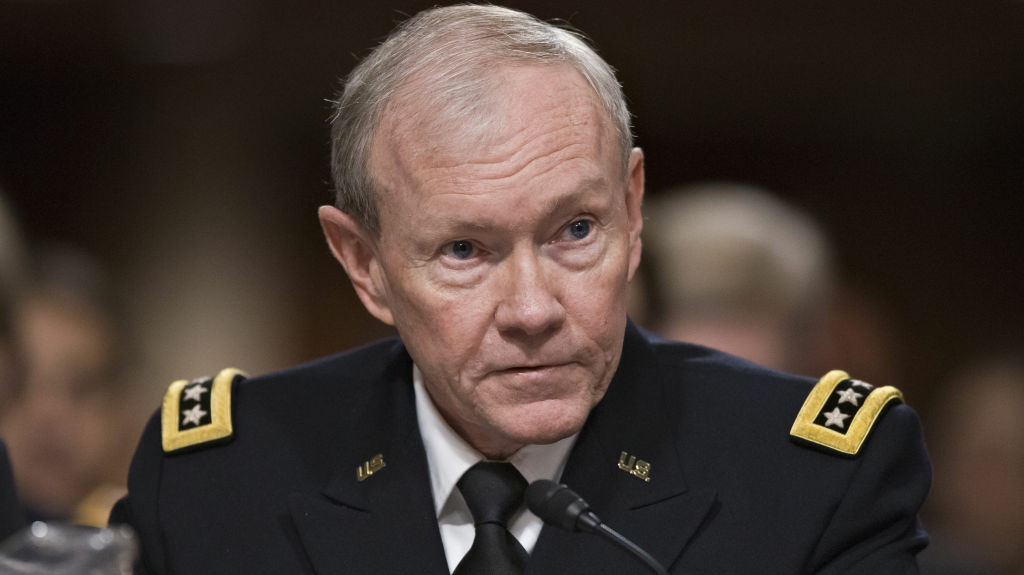 Joint Chiefs Chairman Gen. Martin E. Dempsey testifies on Capitol Hill in Washington on Tuesday, before the Senate Armed Services Committee hearing on the looming cuts to the defense budget.