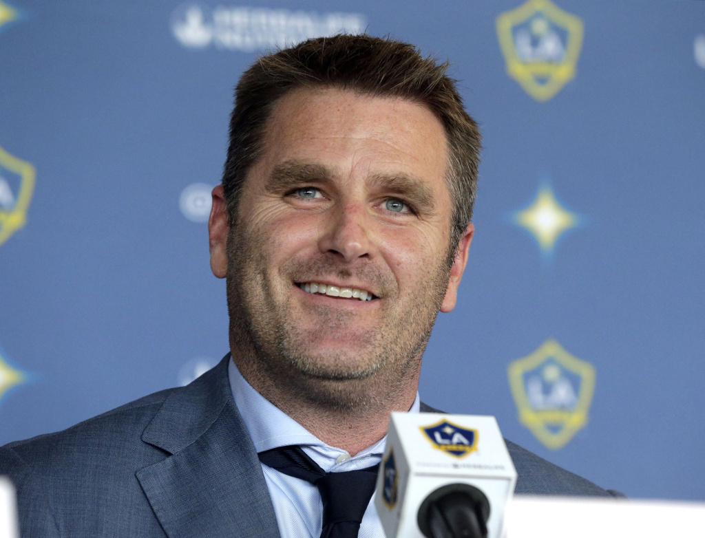 Curt Onalfo smiles as he is introduced as the new head coach of the Los Angeles Galaxy soccer team at news conference in Carson, Calif., Tuesday, Dec. 13, 2016. Onalfo replaces Bruce Arena, who returned to the U.S. national team after guiding the Los Angeles Galaxy to three MLS Cup titles.