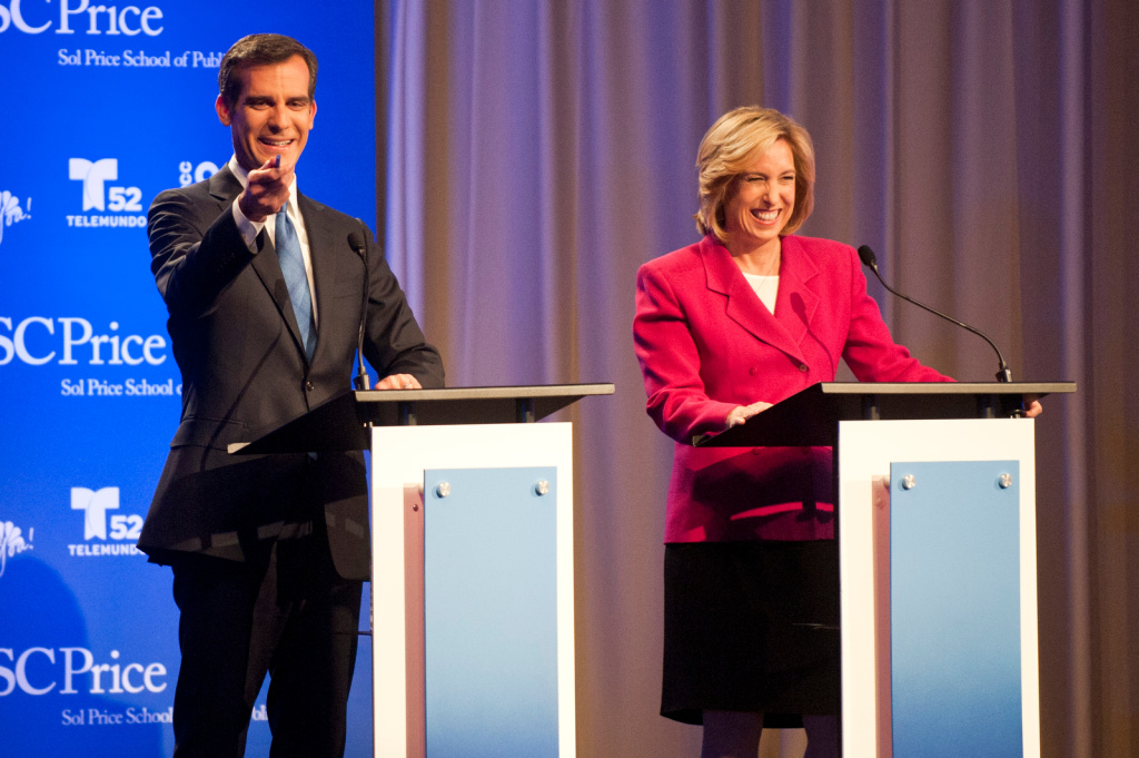 City Councilman Eric Garcetti and City Controller Wendy Greuel greet audience members before taking part in a mayoral debate at USC Health Sciences Campus in Mayer Auditorium on Monday.