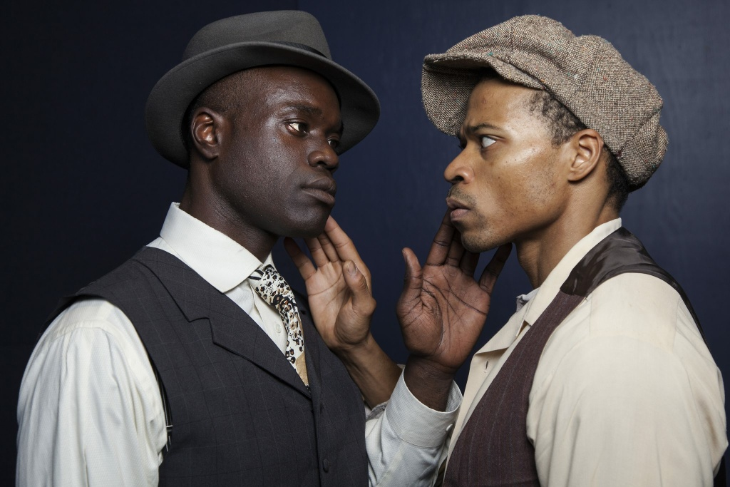 Noel Arthur (left) plays The Black Rat, a manifestation of Bigger Thomas's double consciousness, and Jon Chaffin (right) plays Bigger Thomas in Antaeus Theatre Company's 2018 production of