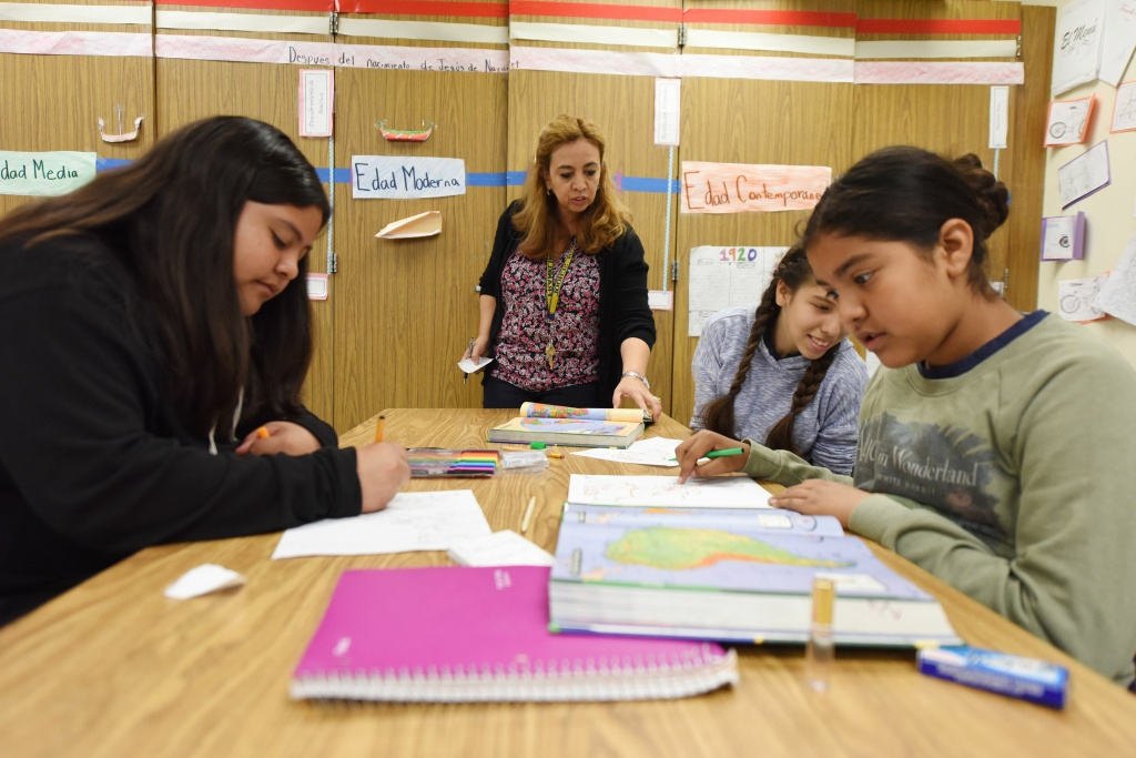 Instructor Blanca Claudio (C) teaches a history lesson at Franklin High School in Los Angeles, California, on May 25, 2017.