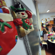 Educators attend chidren in a temporary daycare center set up on Novembre 20, 2008, in Herouville-Saint-Clair, northwestern France, on a national teachers' striking day.
