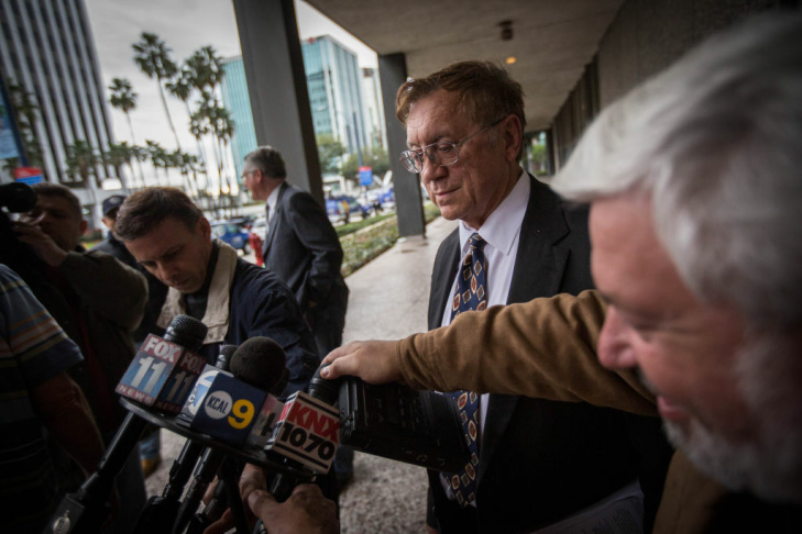 Robert Pimentel (CQ), left, a former fourth-grade teacher charged with multiple counts of sexual molestation, is arraigned by Los Angeles Superior Court judge James Otto, right, in Long Beach, Calif., on Thursday, Jan. 24, 2013. Defense attorney Attorney Richard Knickerbocker, middle.