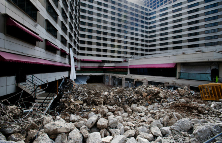 After 60 years of service, the Wilshire Grand Hotel will be demolished in the next year to make way for a new Wilshire Grand hotel and office tower. Some hotel rooms still have furniture, lamps, mirrors, and ironing boards left inside.