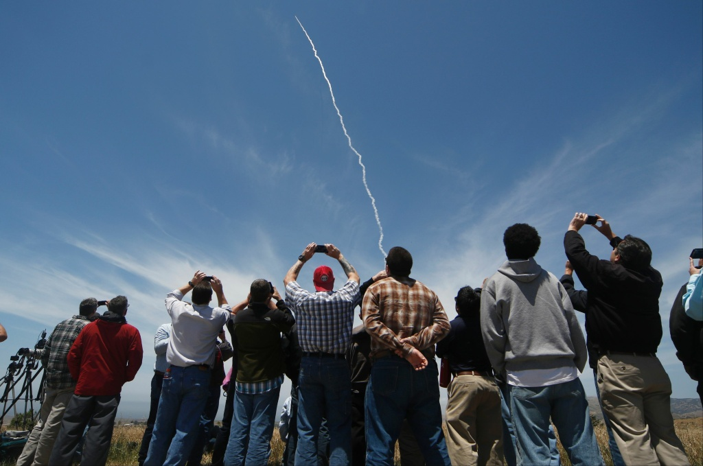 TOPSHOT - People watch a ground based interceptor missle take off at Vandenberg Air Force base, California on May 30, 2017.