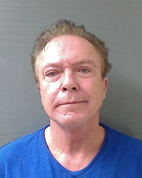 File: In this handout photo provided by the Schodack Police Department, David Cassidy is seen in a police booking photo after his arrest on charges of felony DWI, driving while intoxicated, Aug. 21, 2013 in Schodack, New York.