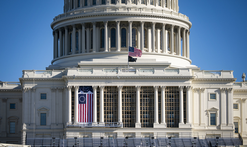 The American flag flies at half-staff on the west front of the U.S. Capitol on Saturday. On Monday, House Democrats introduced an impeachment resolution against President Trump over his role in last week's insurrection.