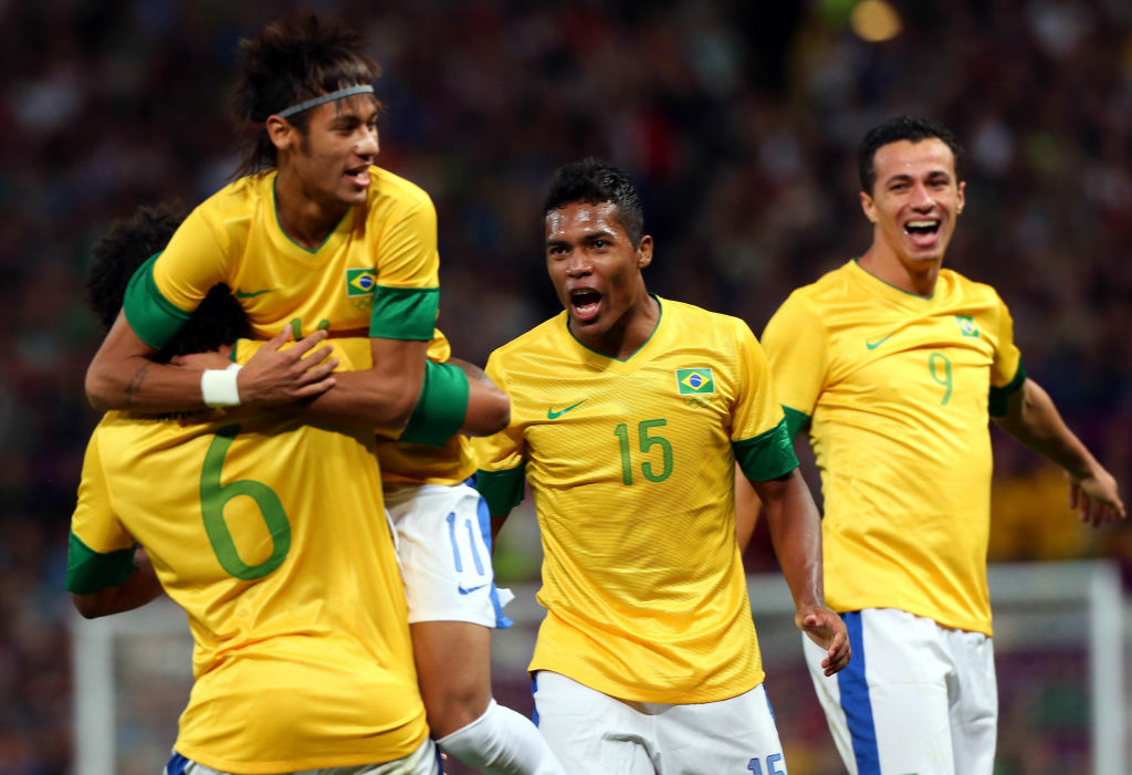Neymar of Brazil and Marcelo #6 celebrate the goal by Leandro Damiao #9 while Alex Sandro looks on during the Men's Football Semi Final match between Korea and Brazil, on Day 11 of the London 2012 Olympic Games at Old Trafford on August 7, 2012 in Manchester, England.