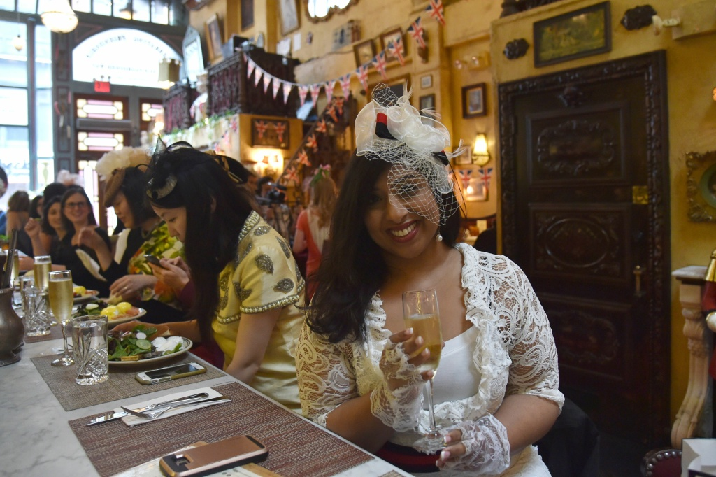 Fans attend a Royal Wedding watching party at Lillie's Victorian Establishment in New York City, on May 19, 2018.