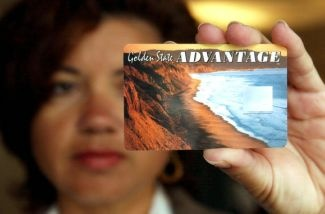 Deborah McFadden holds a sample of the new California State Electronic Benefit Transfer (EBT) card July 17, 2002 in Oakland, California.