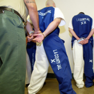 A sheriff's deputy checks the handcuffs jail prison lasd