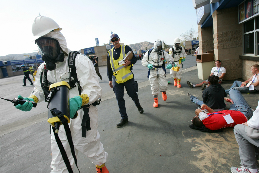 A Hazardous Materials (HazMat) team use bio-toxin detectors as they walk past actors portraying civilians injured in a terrorist attack, during 'Golden Guardian,' California's annual full scale Homeland Security exercise, 14 November 2006 at the Hyundai Pavilion amphitheater in San Bernardino, California.