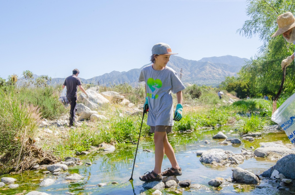 A young volunteer helps clean up the Tujunga Wash during the 2017 Great L.A. River Cleanup, an event founded in 1989 by Friends of the L.A. River.
