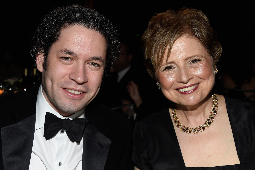 HOLLYWOOD, CA - JUNE 09:  Conductor Gustavo Dudamel (L) and President and CEO of the  Los Angeles Philharmonic Deborah Borda pose in the audience during American Film Institute's 44th Life Achievement Award Gala Tribute to John Williams at Dolby Theatre on June 9, 2016 in Hollywood, California. 26148_001  (Photo by Frazer Harrison/Getty Images for Turner)
