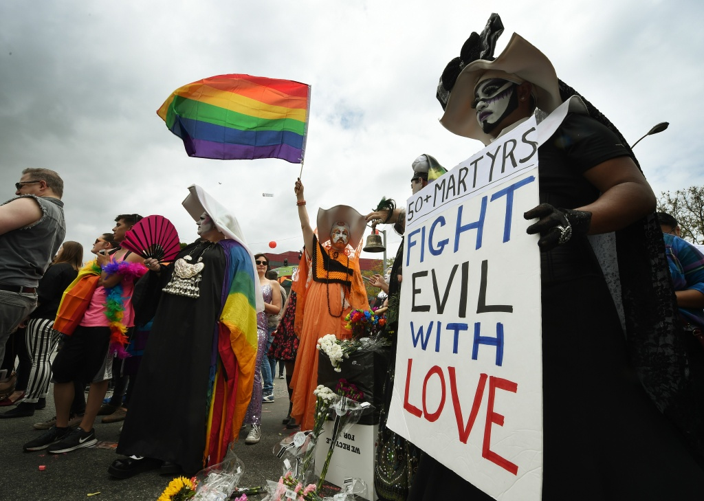 Participants show their support for victims of the Orlando shooting during the 2016 Gay Pride Parade on June 12, 20116 in Los Angeles, California.