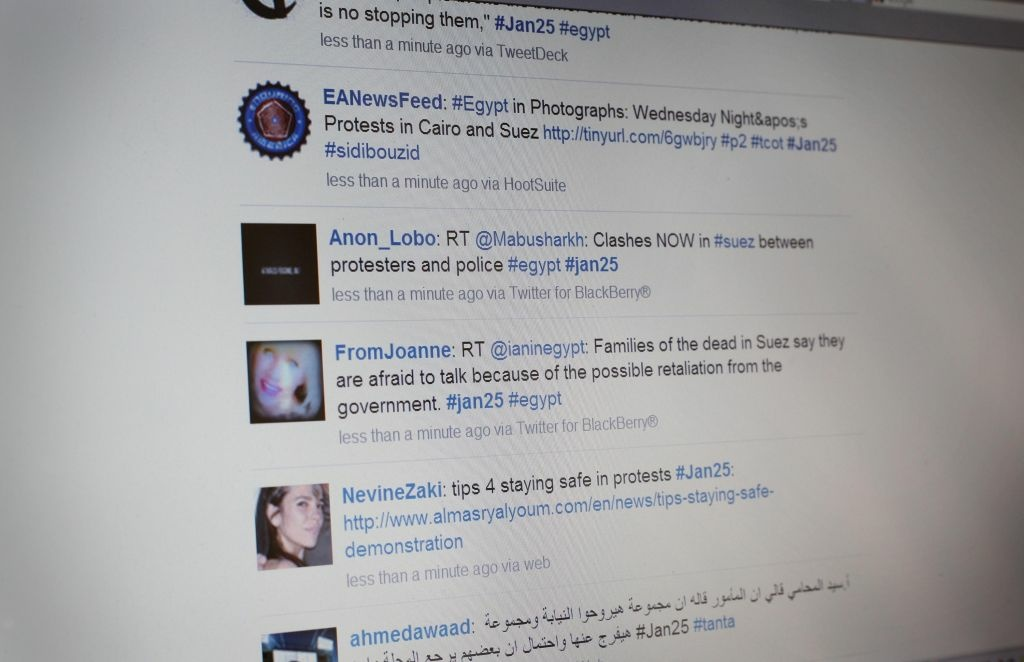 In this photo illustration a laptop computer displays a Twitter feed relating to Egyptian protests on January 27, 2011 in Cairo, Egypt.