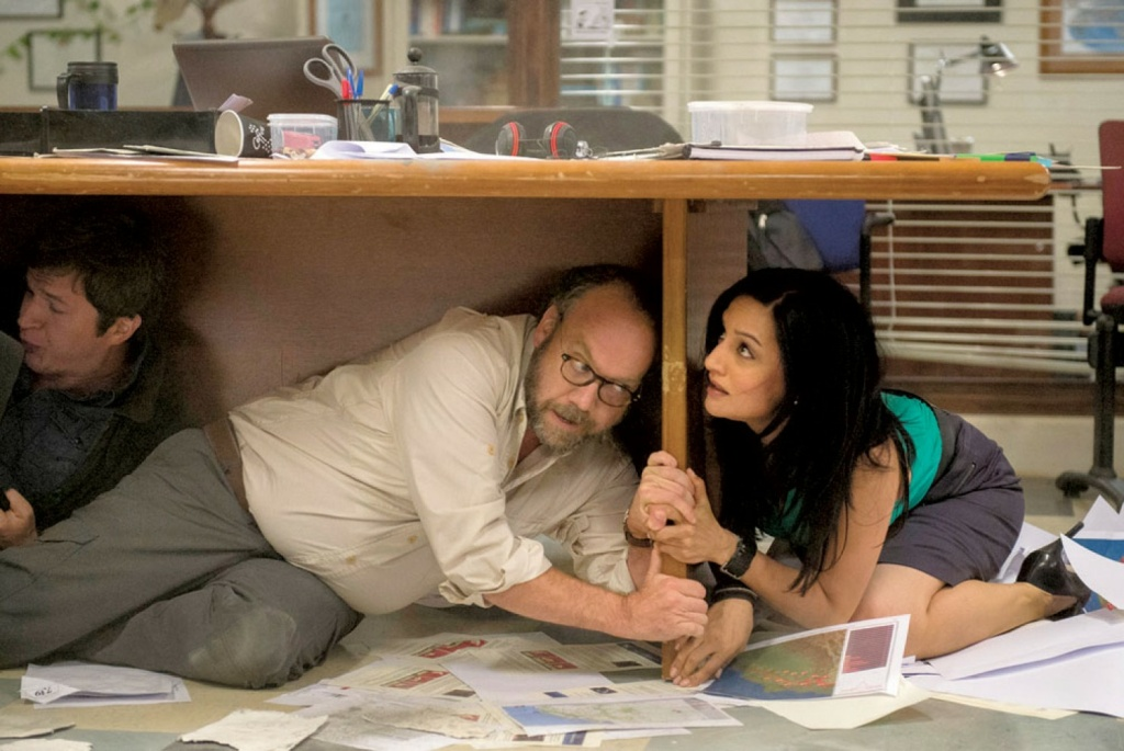 Actors Paul Giamatti and Archie Panjabi demonstrated the correct way to drop, cover and hold on in the film 'San Andreas.'