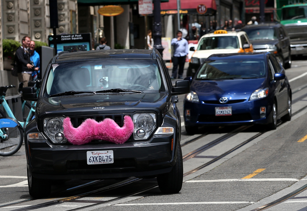 A Lyft car drives along Powell Street on June 12, 2014 in San Francisco, California.