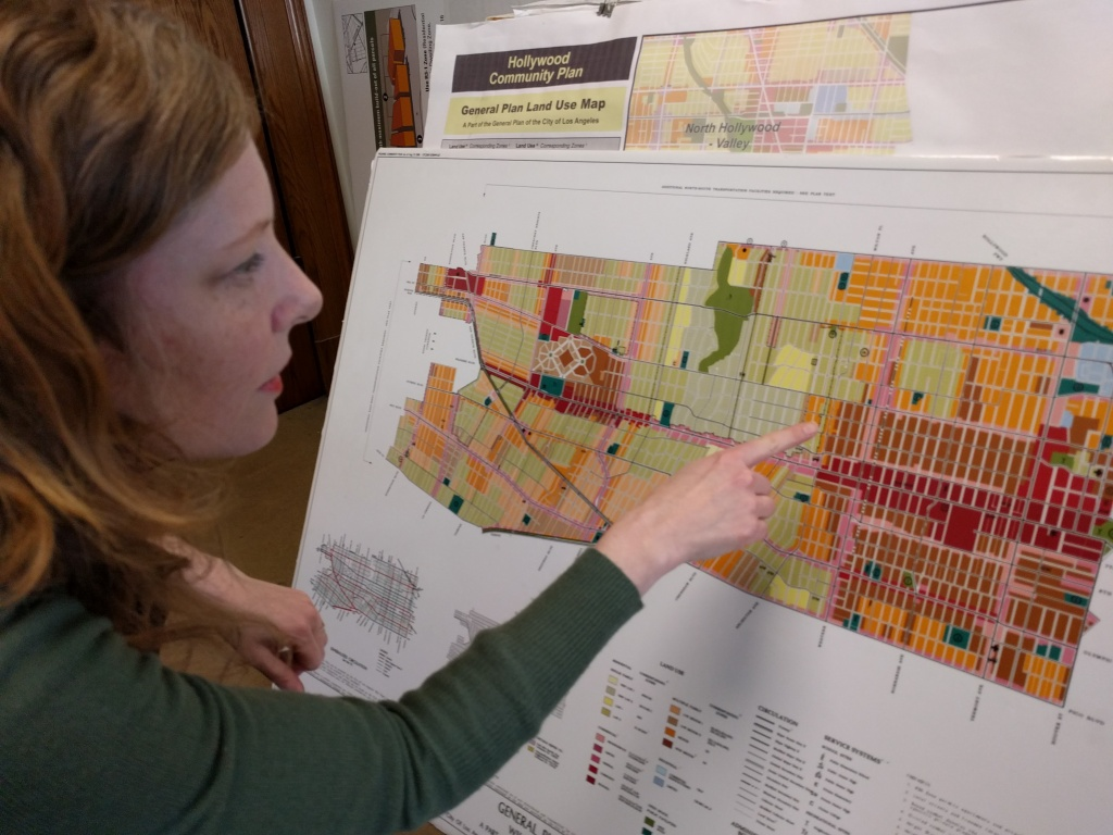 Shana Bonstin, LA's principal city planner, examines the neighborhood zoning map for the Wilshire/Koreatown area.