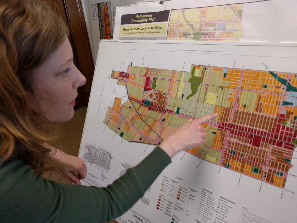 Shana Bonstin, LA's principal city planner, examines the neighborhood zoning map for the Wilshire/Koreatown area.