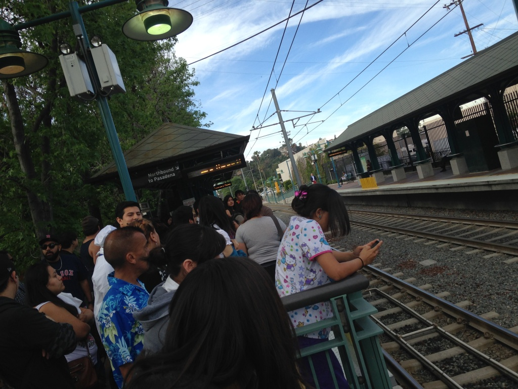 Riders stranded at the South Pasadena Metro station due to a sagging power line on Wednesday, April 9, 2014.