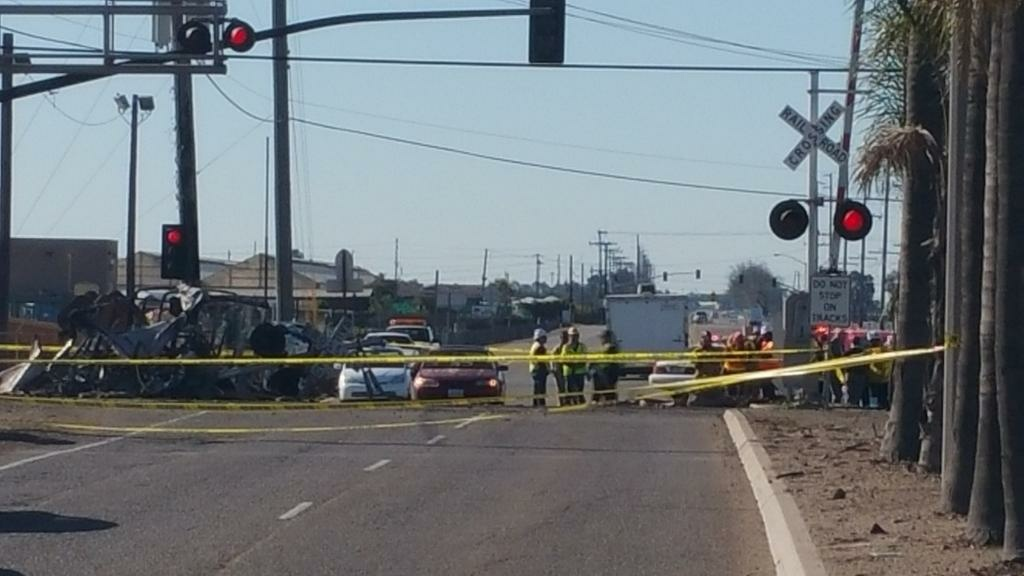 Three cars of a Southern California Metrolink commuter train derailed and tumbled onto their sides after a collision with a truck on tracks in Ventura County northwest of Los Angeles.