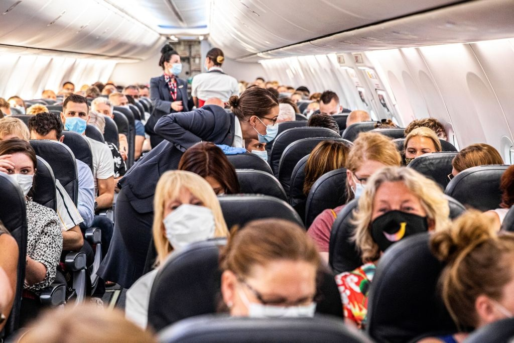 Passengers are welcomed on a Corendon plane departing from Amsterdam's Schiphol airport to Bulgaria's Burgas airport, on June 26, 2020, on the first holiday flight by the travel company since the novel coronavirus in March.